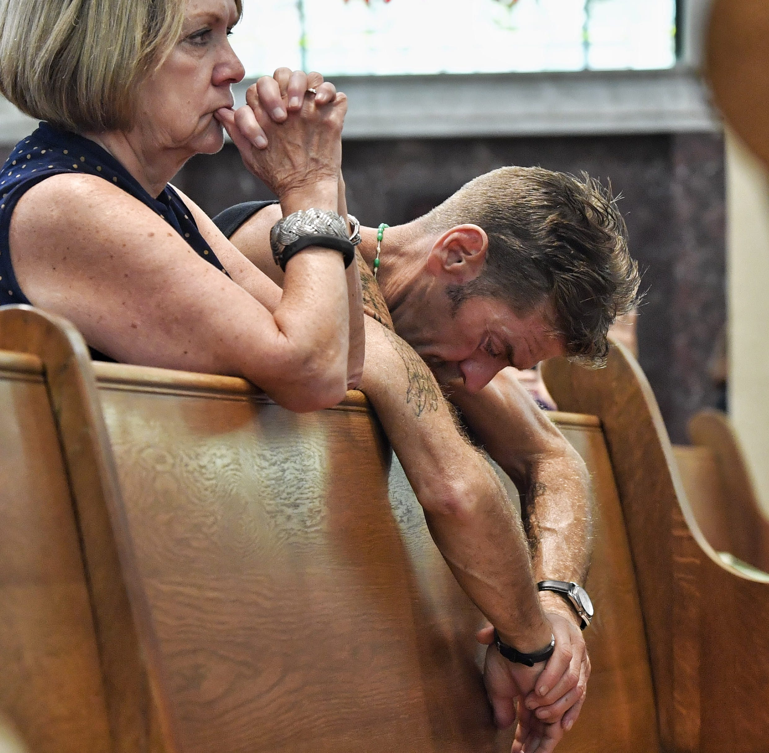 A parishioner prays during communion at the 'Mass of Forgiveness' at the Cathedral Parish of Saint Patrick in Harrisburg on Friday.