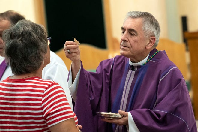 Bishop Ronald Gainer hands out 'the sacrament' during communion during a 'Mass of Forgiveness' at Saint Patrick Cathedral in Harrisburg on Friday, August 17, 2018. The mass was part the Church's 'on-going need for repentance and healing,' according to the Diocese of Harrisburg's website.