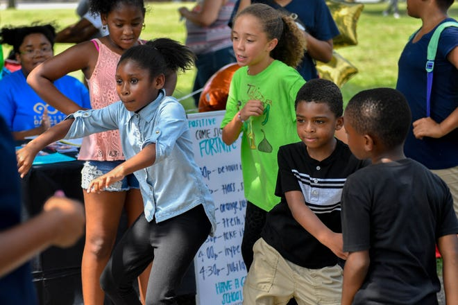 Children show off their dance moves at the City of York's United Back to School Resource Fair on Friday at Penn Park.