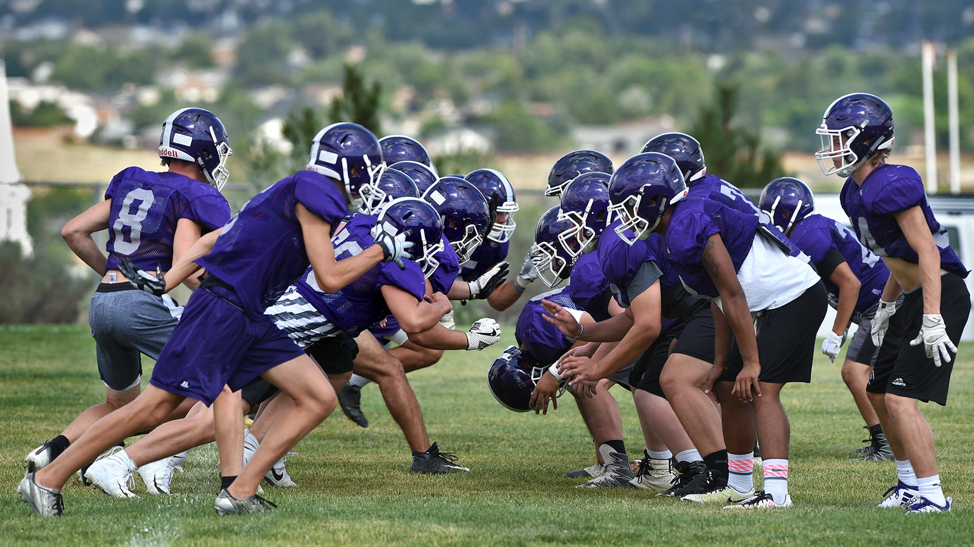 The Spanish Springs football varsity team runs through plays during practice on the school practice field on August 15, 2018.