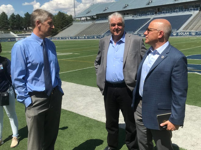 Nevada Athletic Director Doug Knuth, left, Democratic governor candidate Steve Sisolak and Raiders President Marc Badain visit during a site tour Thursday at Mackay Stadium.