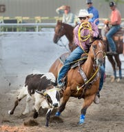 A competitor in Jackpot Team Roping.