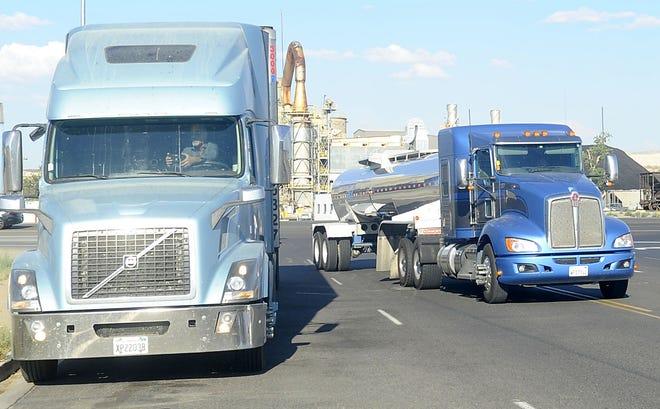 Diesel trucks drive through Fernley.