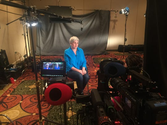 Chris Hempel, the mother of Reno twins with a rare disease, sits during an interview with CNN