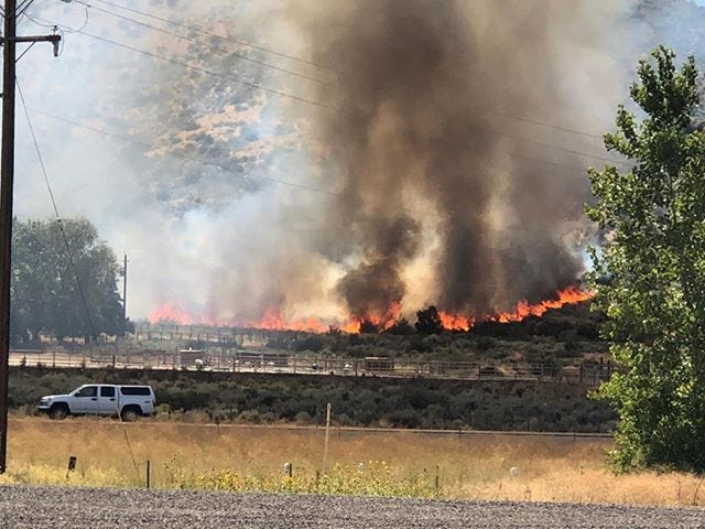 Flames and smoke billow from a fire burning in Washoe Valley on August 17, 2018.