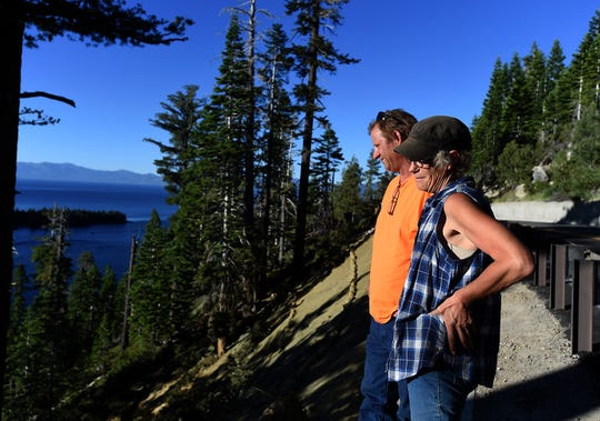 Robert and Rebecca Casebeer stand looking over the side of Highway 89 at Emerald Bay on June 27, 2018.