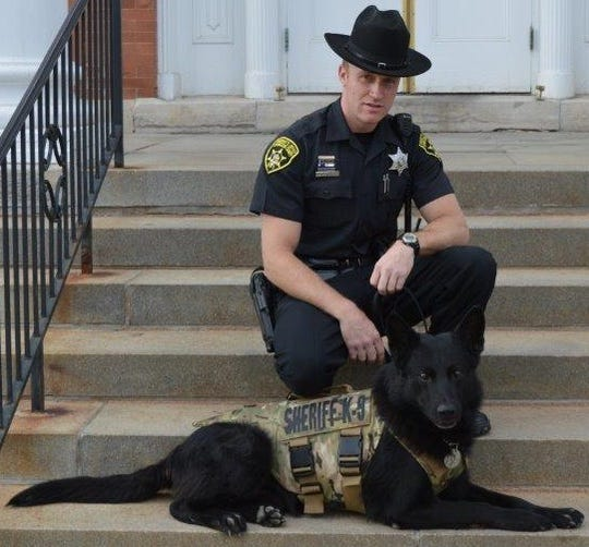 Livingston County Sheriff's Office Sgt. Ryan Swanson with K9 partner Gibbs. The two worked together for more than seven years.