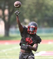 Wilson's Rickey Gamble throws on the side during practice.