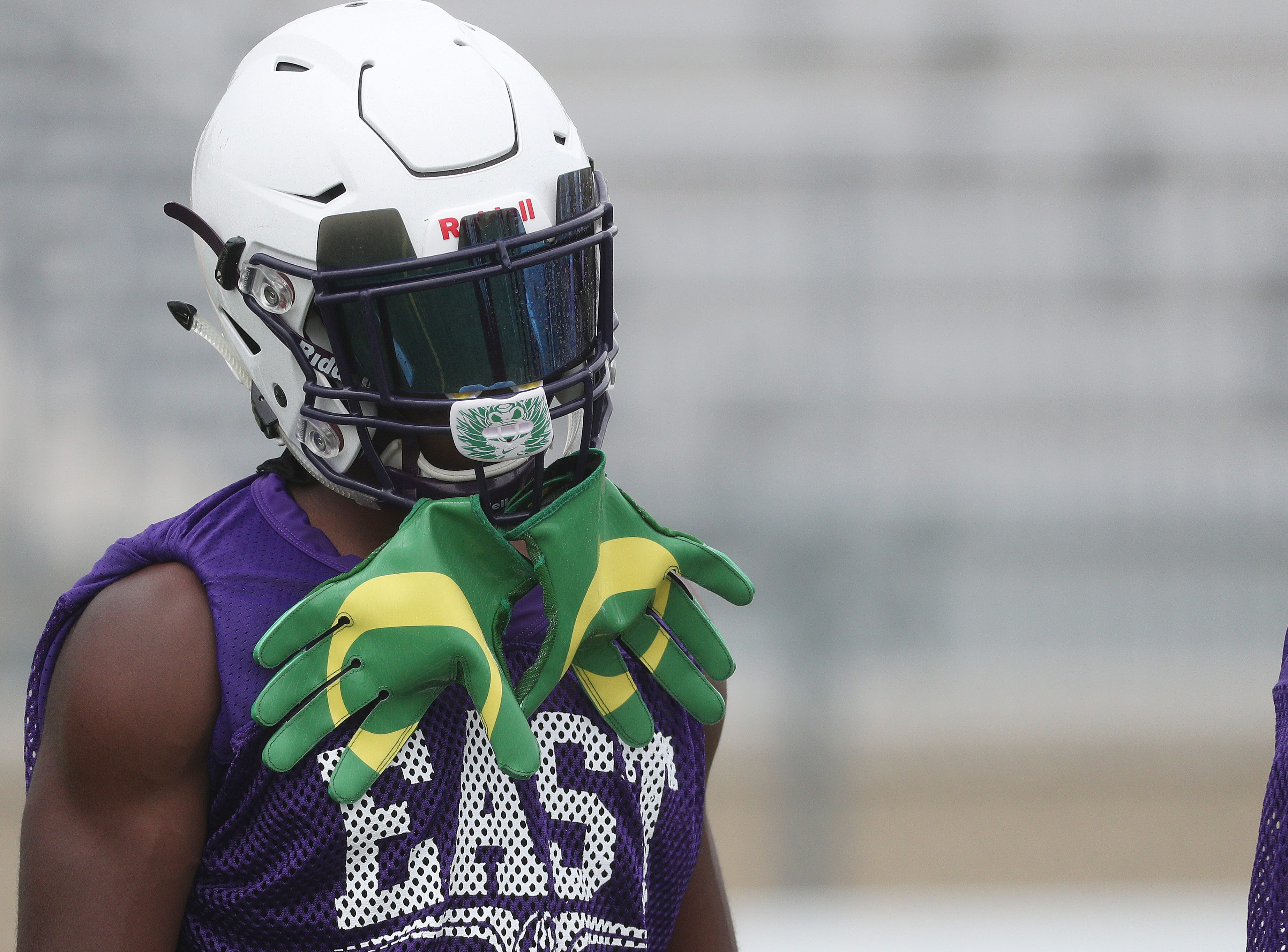 East's Seven McGee in the huddle during practice on Friday, Aug. 17, 2018 in Rochester, N.Y. The highly touted sophomore has made a verbal commitment to play for the University of Oregon.