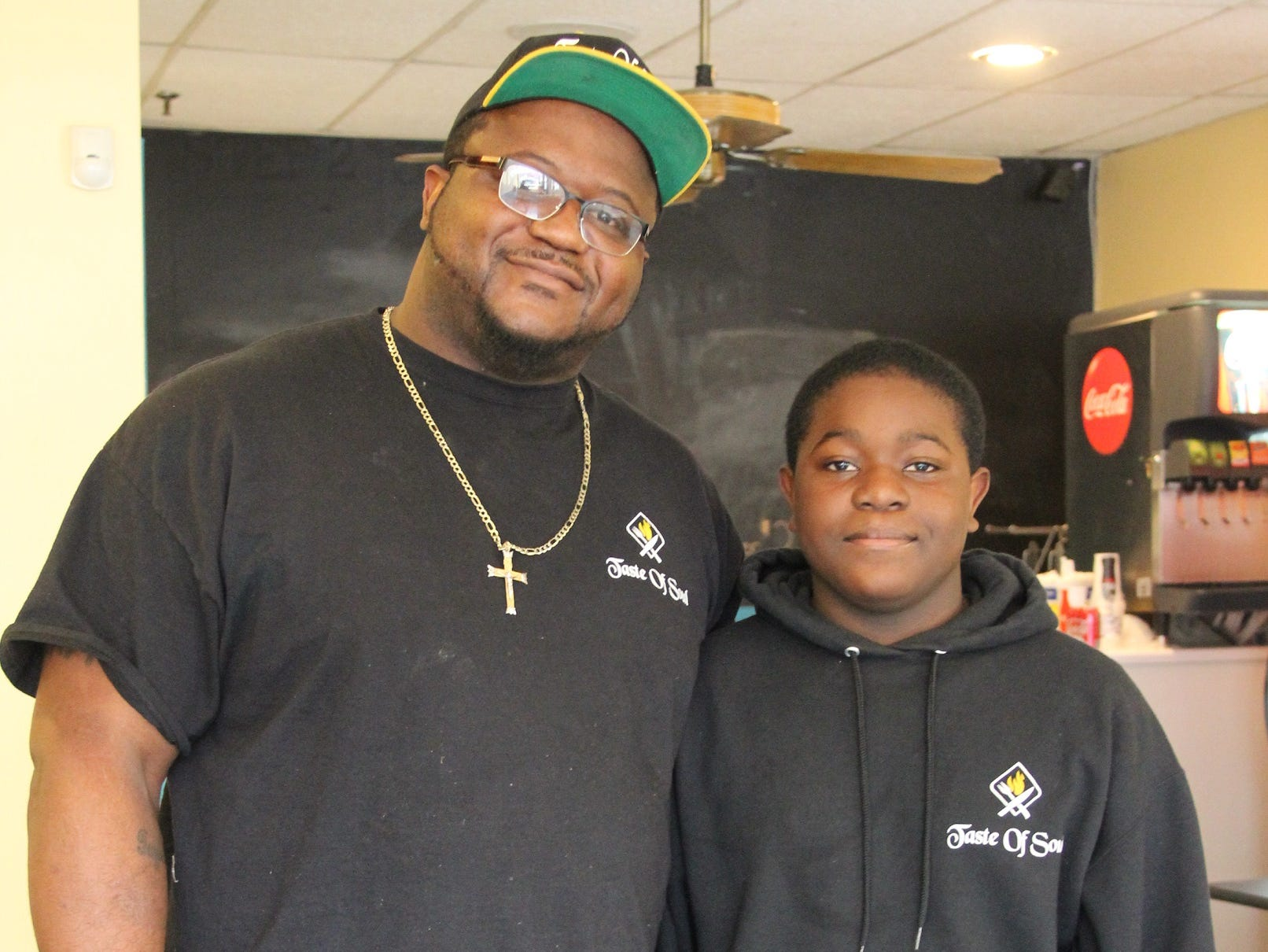 Taste of Soul owner Tim Lee, 38, of LeRoy, Genesee County, and his son Timothy Lee Jr.