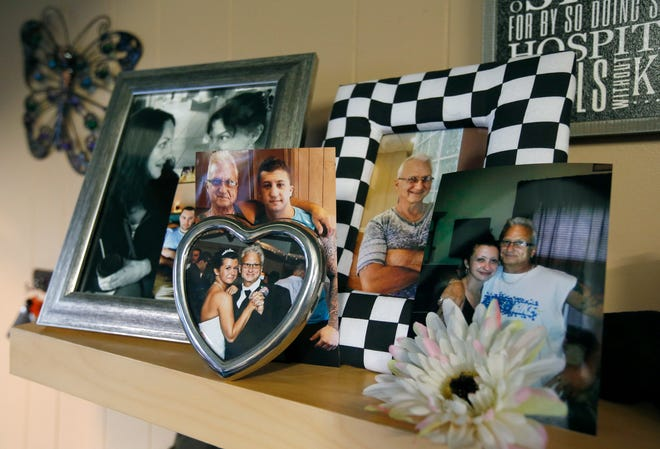 Family photos of David Lana, who died in January 2018 of an opioid overdose, sit on the mantel of his home where his widow, Angela, hosted a  S.O.A.R.S. support group.