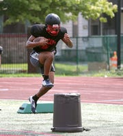 Running back Desi Floyd Jr. running drills during practice.