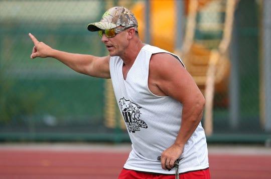 Wilson head coach Greg Mortier runs a drill during practice.