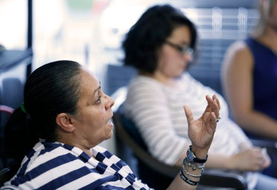 Wanda Martinez, front, and her daughter Vanessa Desmore attended a recent meeting of the grief support group. Martinez talked about the death of her son William F. Martinez, and Desmore shared what her brother's death meant to her.