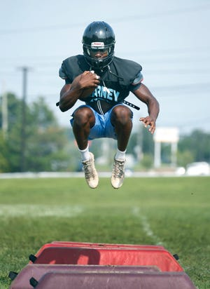 Bishop Kearney running back Nathan Carter goes through agility drills during football practice.