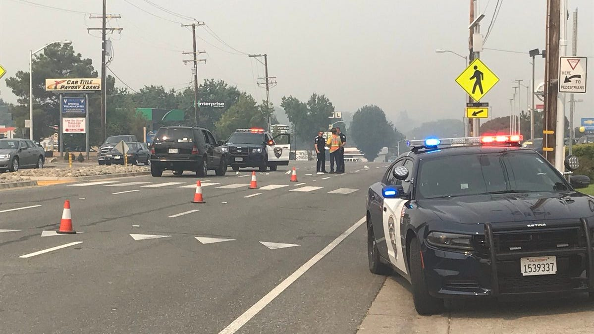 Redding police investigate a Friday morning collision between a pedestrian and a vehicle on Cypress Avenue near Big O Tires and Crown Nissan. Westbound Cypress was closed at Rosemary Avenue.