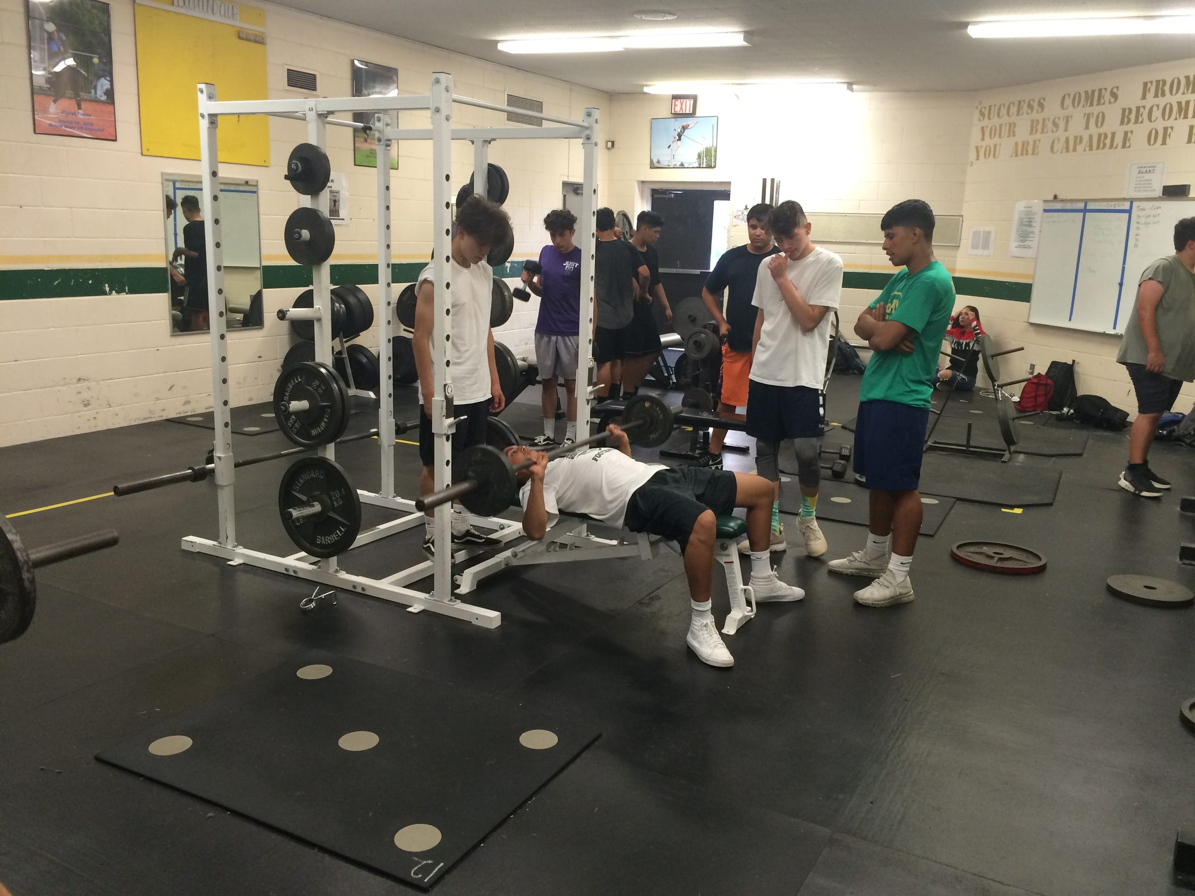 McKay football players work out in the weight room as practice was forced inside due to concerns about air quality on Wednesday, Aug. 15, 2018.