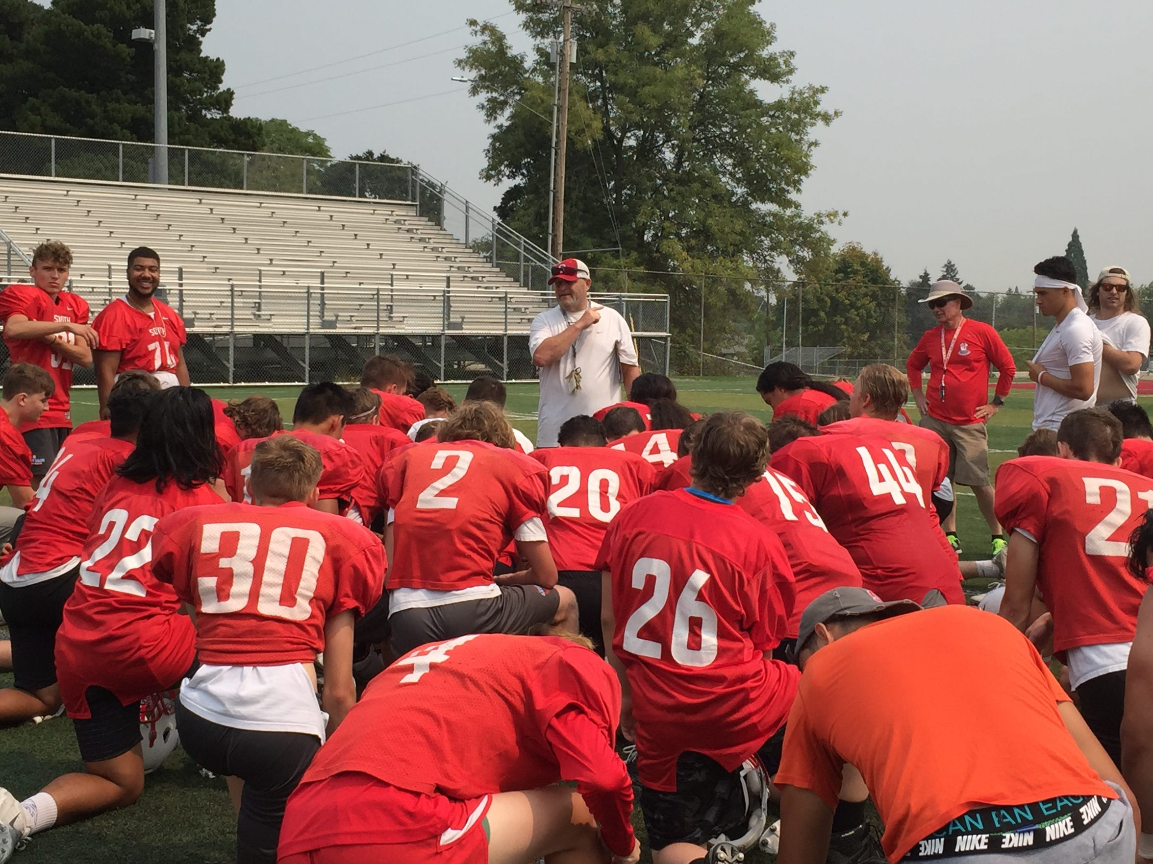 South Salem coach Scott DuFault talks to his team after practice on Aug. 15, 2018.