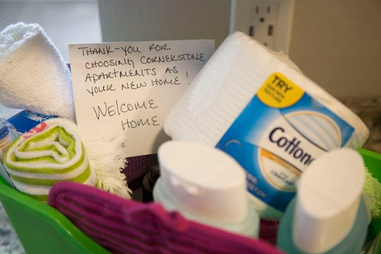 A welcome basket sits on the counter to greet the Qualey family as they move into their new apartment at the Cornerstone Apartments in Salem, Oregon, Thursday August 16, 2018. Thursday August 16, 2018. The complex is the first in a set of Local Innovation and Fast Track homes to open after Oregon lawmakers approved $40 million in awards toward the program in 2015.