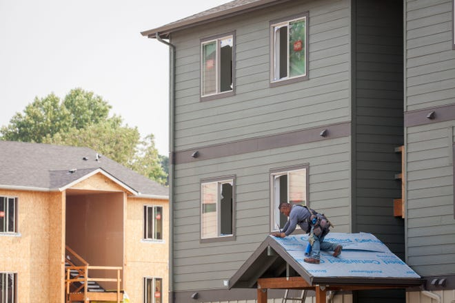 Construction on new units continues as residents begin to move-in at the new Cornerstone Apartments in Salem, Oregon, Thursday August 16, 2018. The complex is the first in a set of Local Innovation and Fast Track homes to open after Oregon lawmakers approved $40 million in awards toward the program in 2015.