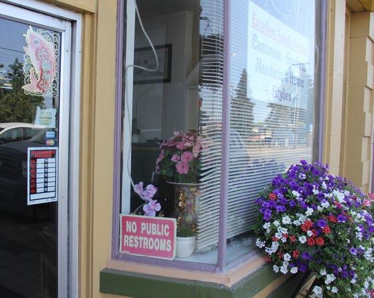 """The """"No Public Restrooms"""" sign in front of Bing's Happy Garden restaurant in Mt. Angel."""