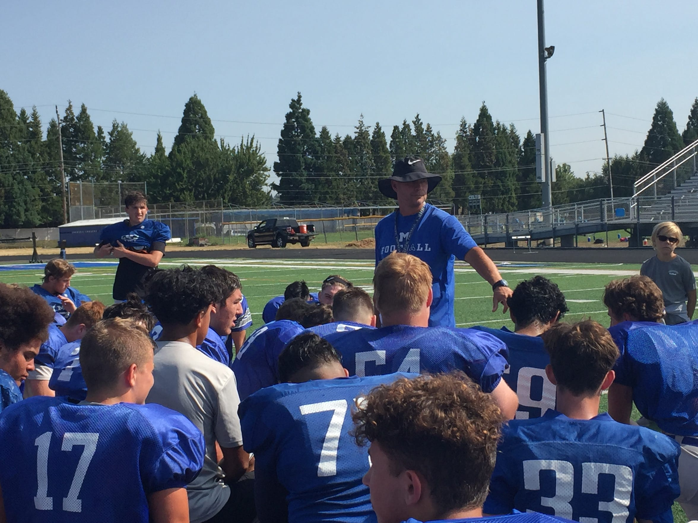 McNary coach Jeff Auvin addresses his team after practice on Aug. 17, 2018.