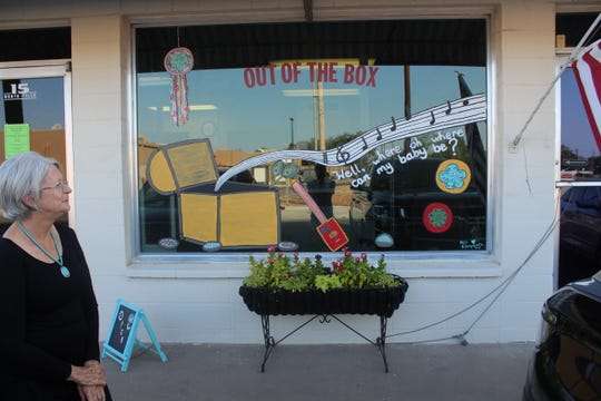 Jan Mullins stands at the storefront of Out of the Box, 15 North Tyler St., Wednesday, Aug. 1, 2018.