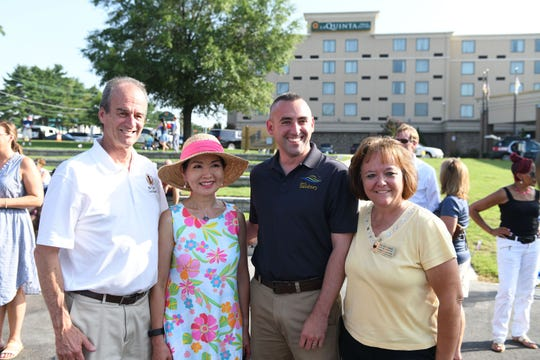 County Executive Bob Culiver, First Lady Yumi Hogan, Mayor Jake Day and Chamber of Commerce Nicole Green pose for a photo during the Riverwalk Amphitheater Ribbon Cutting event on Friday, August 17, 2018.