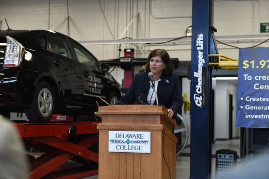 Linda Cruz-Carnall, regional director of the U.S. Economic Development Administration, speaks during the announcement of a $1.97 million grant for an Automotive Center of Excellence at Delaware Technical Community College's Georgetown Campus on Friday, Aug. 17, 2018.