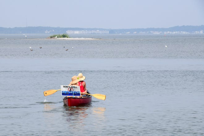 "Susan Emond and Kathy Hayes paddle into the bay near Ocean City  for the 4th annual ""Float for the Coast"" rally on Friday, August 17."