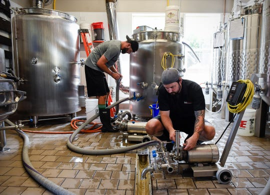 Aaron Rieland and Erik Salmi get ready to brew another batch at Bad Habit Brewing Tuesday, Aug. 14, in St. Joseph.