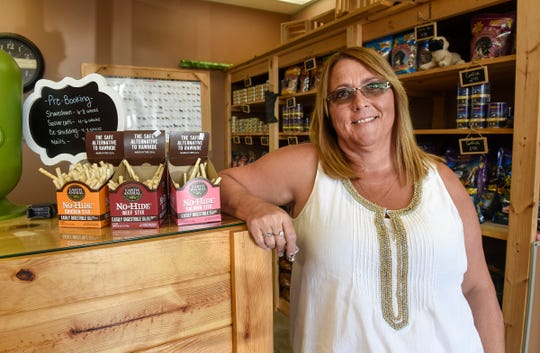 Owner Kelly Thompson stands in the retail and reception area Thursday, Aug. 16, at Knotty Paws in Sartell.