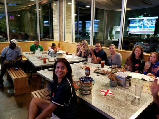 Parents and fans gather at Island Wing Company Thursday night to watch Tallahassee's win over Mifflin County in the 15U Babe Ruth World Series title game in Longview, Washington.