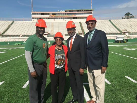 FAMU football head coach Willie Simmons, Dr. Shawnta Friday-Stroud, Dr. Larry Robinson and Dr. Larry Eason sport the commemorative hard hat in celebration of the completion of the field turf at Bragg Memorial Stadium.