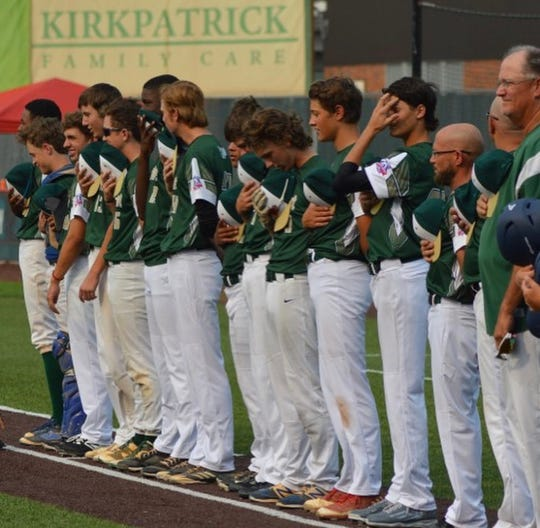 TLBR 15U players line up for the national anthem before Thursday's Babe Ruth World Series champio