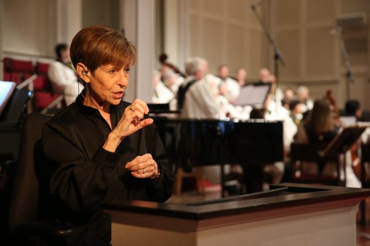 Director of the Deaf Ministry at First Baptist Church Bonnie Snyder interprets for deaf members of the congregation last year.