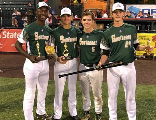 TLBR 15U players Argene Lynn, Ethan Miller, Jack Sturgis, and A.J. Thorp celebrate a Babe Ruth World Series title.