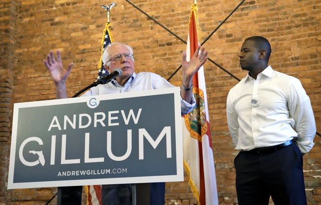 U.S. Sen. Bernie Sanders, I-Vt, left, gestures as he stands with Democratic gubernatorial hopeful Andrew Gillum during a campaign stop for Gillum Friday, Aug. 17, 2018, in Tampa, Fla. (AP Photo/Chris O'Meara)