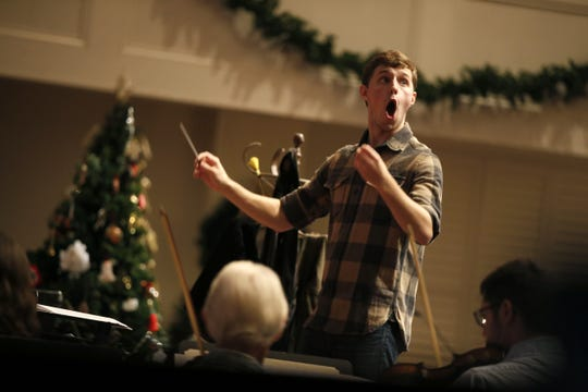 Sam Carlton leads the orchestra and choir Wednesday during a dress rehearsal for the First Baptist Church during a Christmas play in 2015.