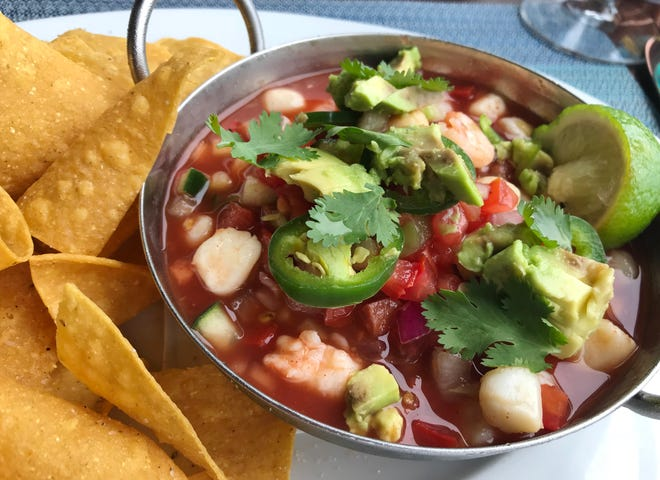 """Kyle G's Prime Seafood's ceviche had scallops and shrimp cured in lime and served in a cool clamato """"broth"""" with chopped tomatoes, cucumber, red onion, jalapeno slices, avocado and a sprinkling of cilantro. It was served with crispy tortilla chips."""
