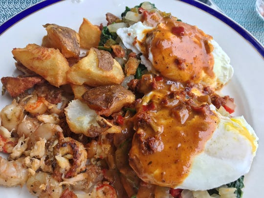 Kyle G's Bayou Benny was spicy and flavorful soft poached eggs atop greens on English muffin halves with blackened shrimp, crawfish, peppers, onions, crumbled chorizo and a jambalaya Hollandaise.