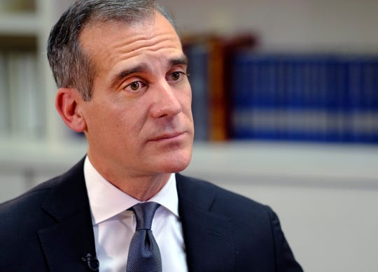 In this file photo, Los Angeles Mayor Eric Garcetti talks during an interview with The Associated Press in Los Angeles.