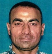 Omar Abdulsattar Ameen was arrested in Northern California on a warrant alleging that he killed an Iraqi policeman while fighting for the Islamic State organization.