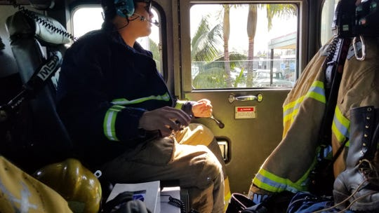 Brandon Bencomo, a Ventura Fire Department firefighter, sits in Medic Engine No. 7 on the way to a call Monday.