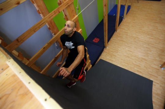 Noel Reyes, Ninja trainer at Westchester Gym in Elmsford, runs up the Warped Wall in the new Ninja Warrior Room at the gym Aug. 17, 2018. Many of the obstacles in the room are replicas of the obstacles contestants on the American Ninja Warrior television show must successfully complete. Reyes has been a contestant on the show multiple times.