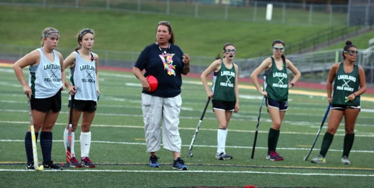 Lakeland varsity field hockey coach Sharon Sarsen instructs her team during practice Aug. 16, 2018. Sarsen goes into this season having won twelve state championships as head coach and nine straight state titles.