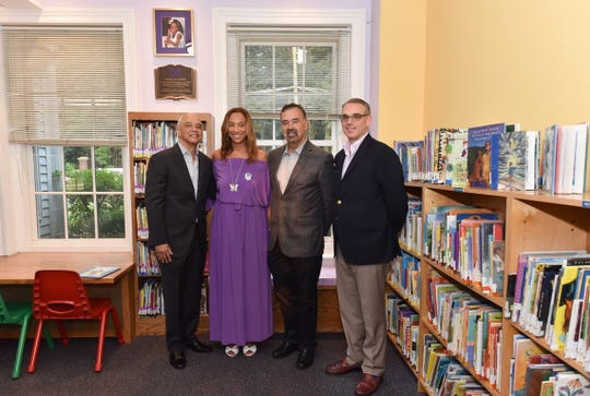 A corner of the Huguenot Children's Library in downtown New Rochelle has been dedicated to Gabrielle White, a 7-year-old who was killed by her father in 2017. Pictured: Noel Hord, Michelle Hord White, Tom Geoffino and Chuck Burke| Provided by New Rochelle Public Library | August 17, 2018