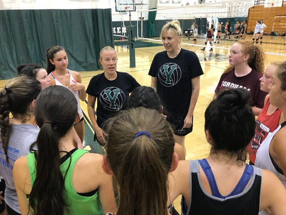 Yorktown volleyball head coach Gigi Kemp (middle) talks to the team during practice on Friday, Aug. 17, 2018.