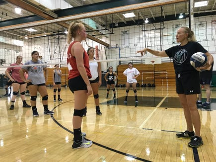 Yorktown volleyball head coach Gigi Kemp sets up a drill during practice on Friday, Aug. 17, 2018.