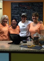 "Diane Stimson, center, with her ""support team"" at The Pastry Palate Cafe in Carmel."